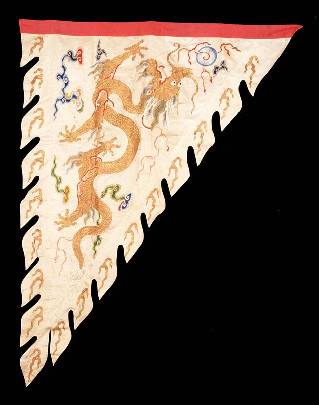 Banner--war flag?--of embroidered white satin with elaborately shaped and scrolled lower border. Design of five-clawed dragons in gold; clouds, Heavenly Jewel, etc in colored silks. Companion to 42.8.283. Lining of thin cerise silk. Note these said to have belonged to Tzu Hui.