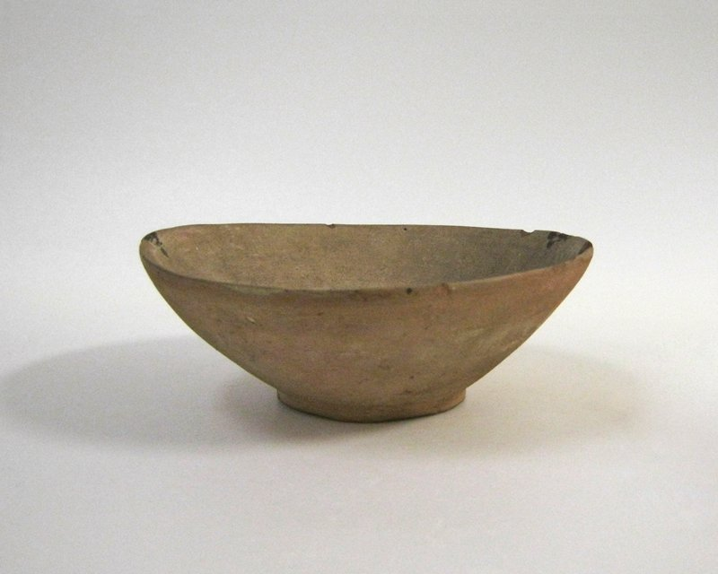 Shallow bowl to hold ceremonial vase, 43.2.19. Vase and bowl were found together in the same grave.