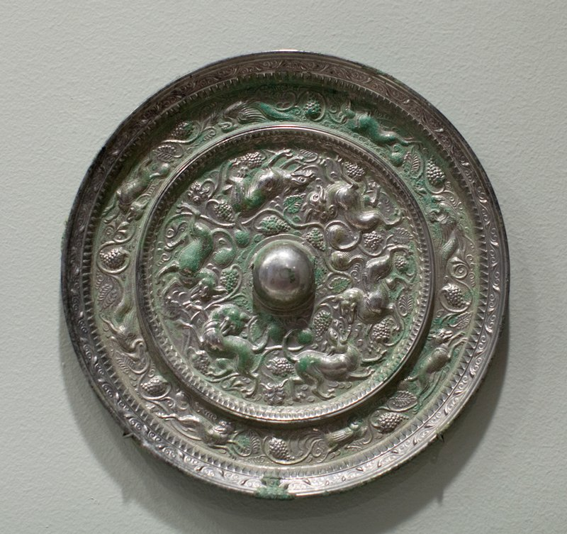 Round, silverized, animal and grape design