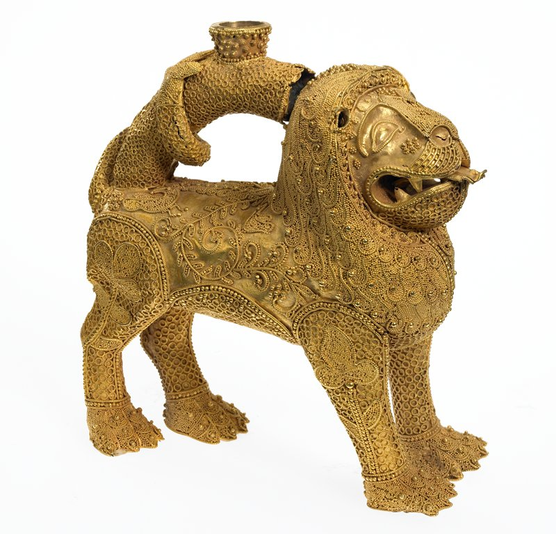 Lion; standing on its four paws, the tail arched over the back; surface decorated with very fine granulation and tiny ringlets of twisted wire; gold