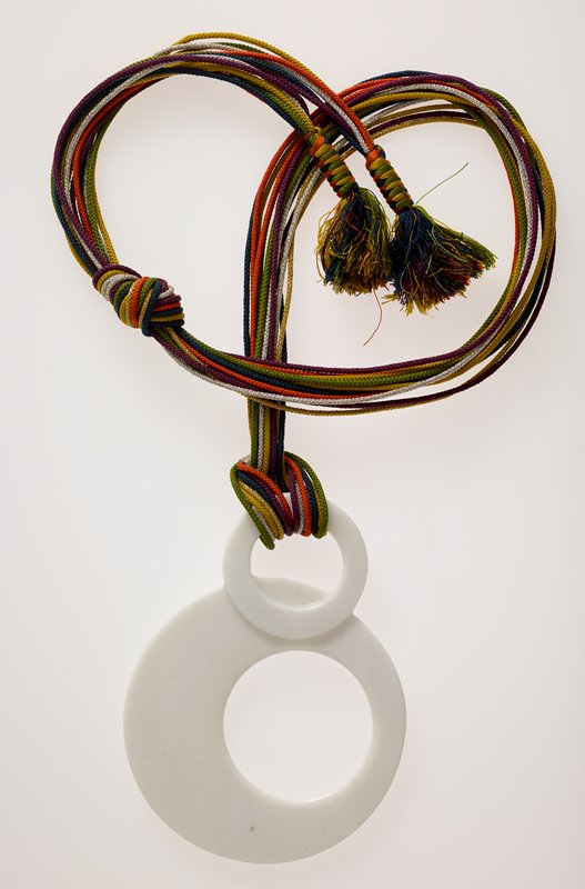 necklace of two joined circles suspended from lengths of multi-colored cord; white Carrara marble