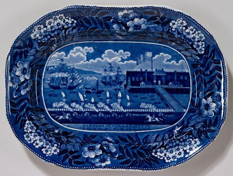 platter; pottery not porcelain ; soft-paste porcelain with a commemorative scene of Lafayette landing in new york(1824) in transfer-printed underglaze blue