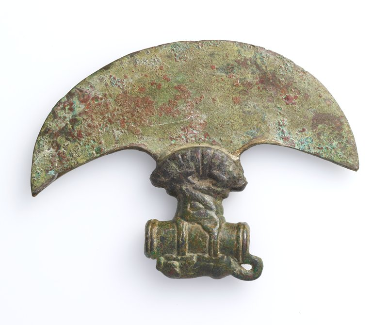 axe head with crouching lion and animal heads. Arms and Armor-Edged Weapon