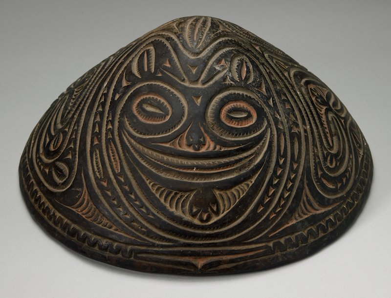 conical food dish; incised whirl decoration and two faces; Wombun Village