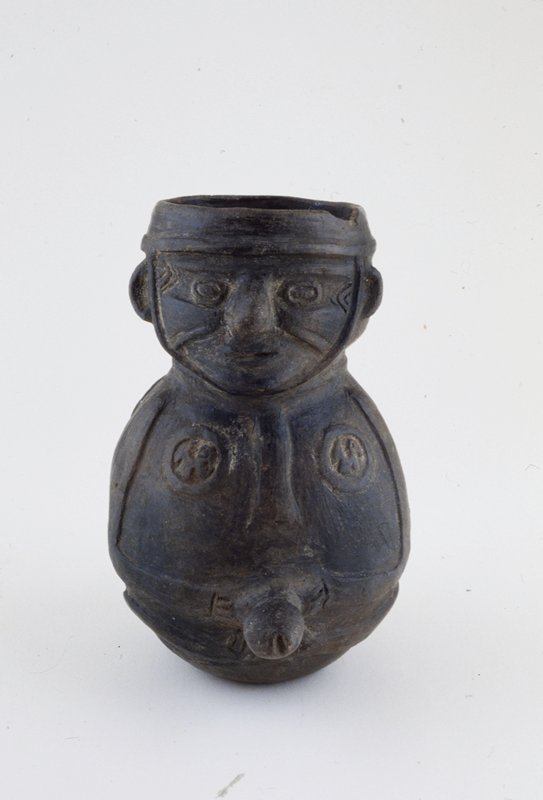 jar in form of erotic figure designs,ceramic, Peruvian (Chimu), 700-1470AD cat. card dims H 7-1/4'