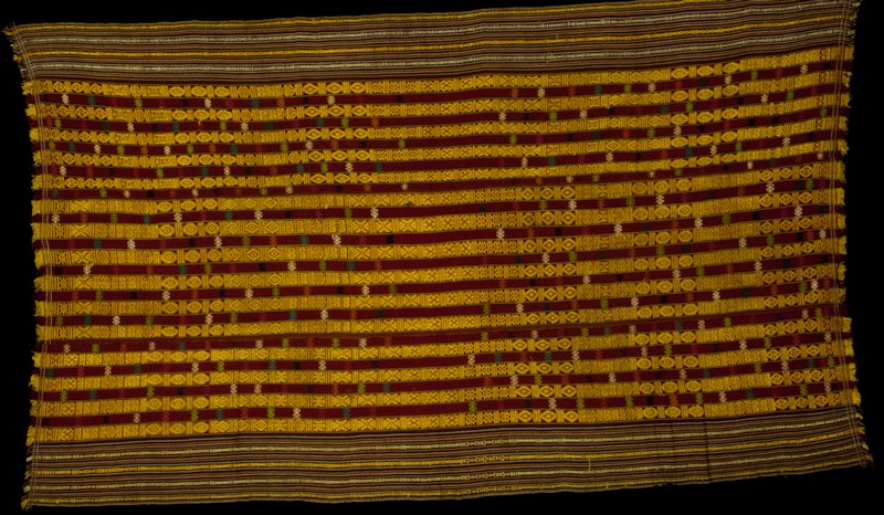 Kira, Mensi Mattha; silk/cotton striped brocade on silk/cotton background; L.91 in., W.52-1/2 in. 3 panels, predominantly gold and maroon stripes with supplementary warp pattern and wool supplementary weft medallions; striped edge borders; fringed.