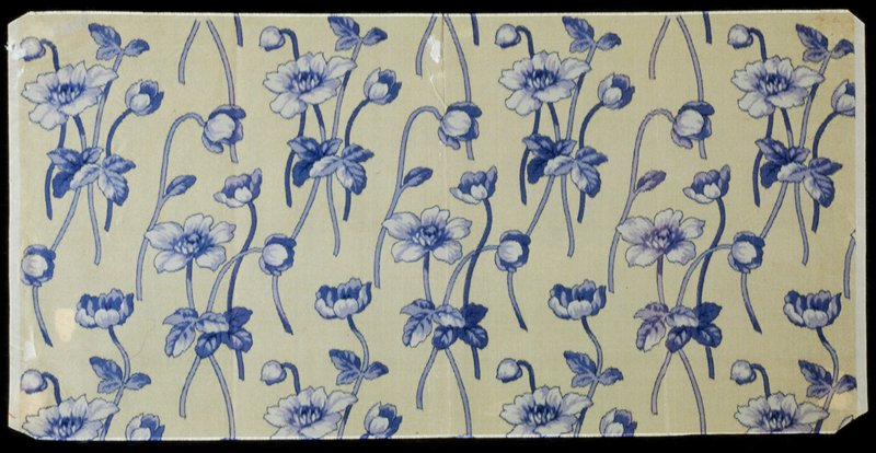blue flower motif repeated on an ivory background