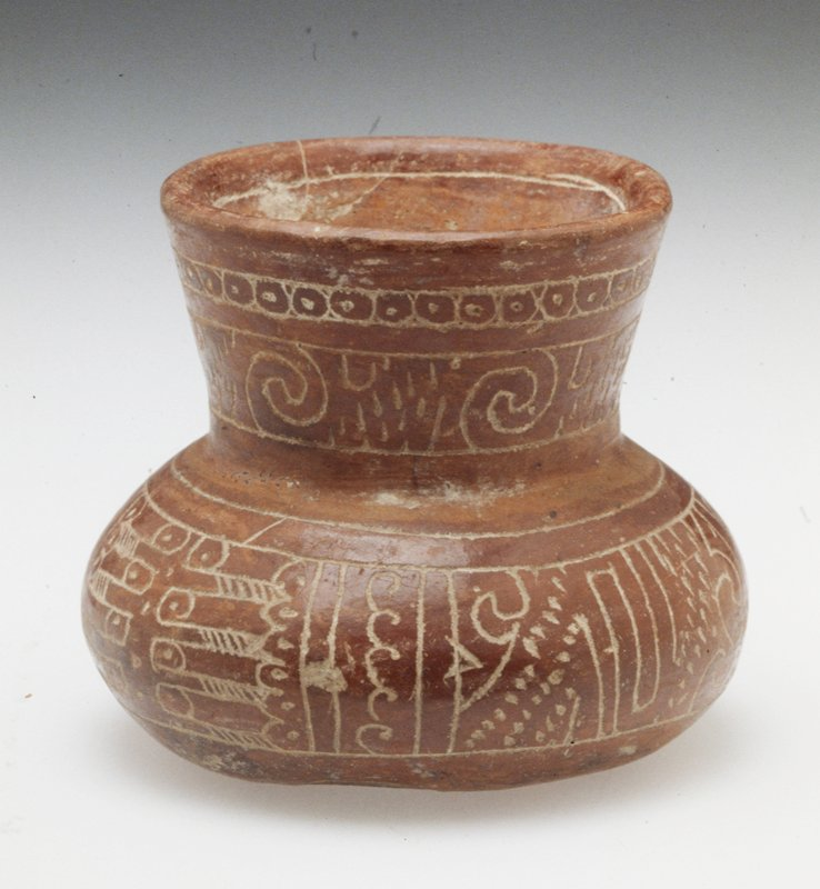 globular bowl with missing tripodal legs and flared spout; buff earthenware with red pigment and incised designs; H. 3 1/2 in.; diameter at mouth 3 in.
