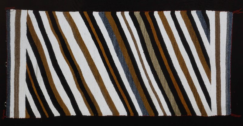 rug, c.1970, wool, with diagonal strips in brown, grey, black and white.