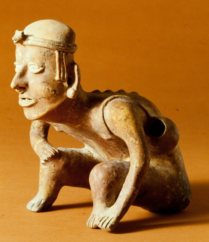 seated male, clay, pigments, West Mexican (Colima), 200 - 700 AD. Figure makes noise when figure is turned over.