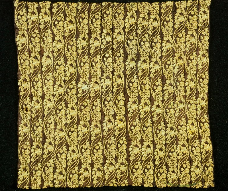Panel of Sari Borders, brown silk with gold embroidery. Accessioned retroactively for 1985, March 11, 1986
