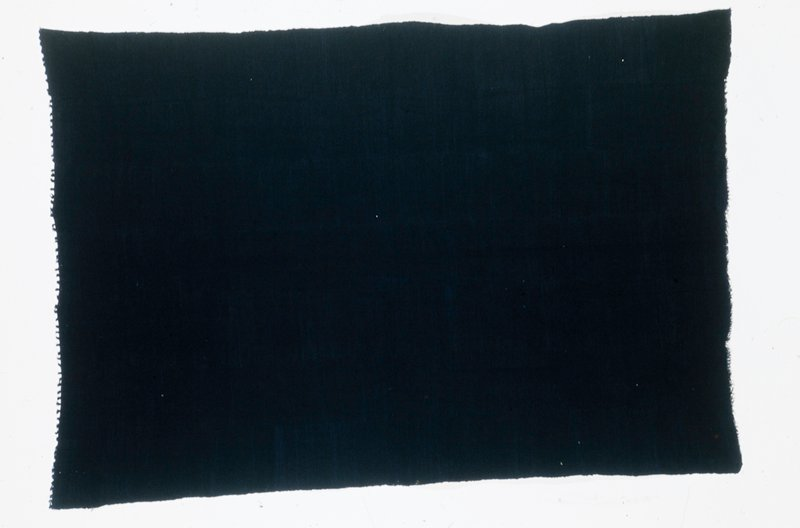woman's skirt length, cotton, indigo dye, African XXc stored in box; dims 59 x 40'; stored with 85.125.4,7,8,11 Name of cloth: Gala or indigo. Friges added after weaving to prevent unravelling and to enhance its appeal. Worn by young women.