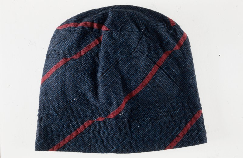 man's outfit including cap, pants, shirt, cotton, embroidered, lined, African (Nigerian); stored in box; 'Simmons'; dark blue with red strips