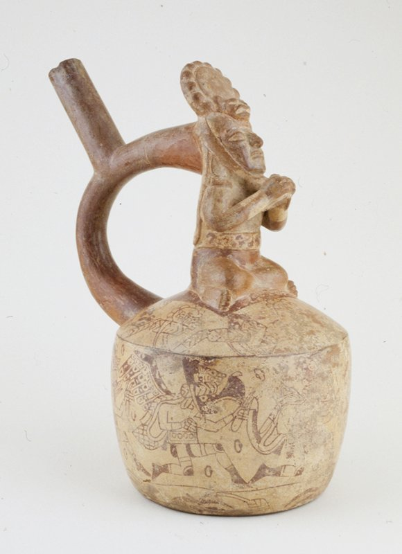 stirrup pot with a warrior sitting cross-legged on top; figures painted in red on cream