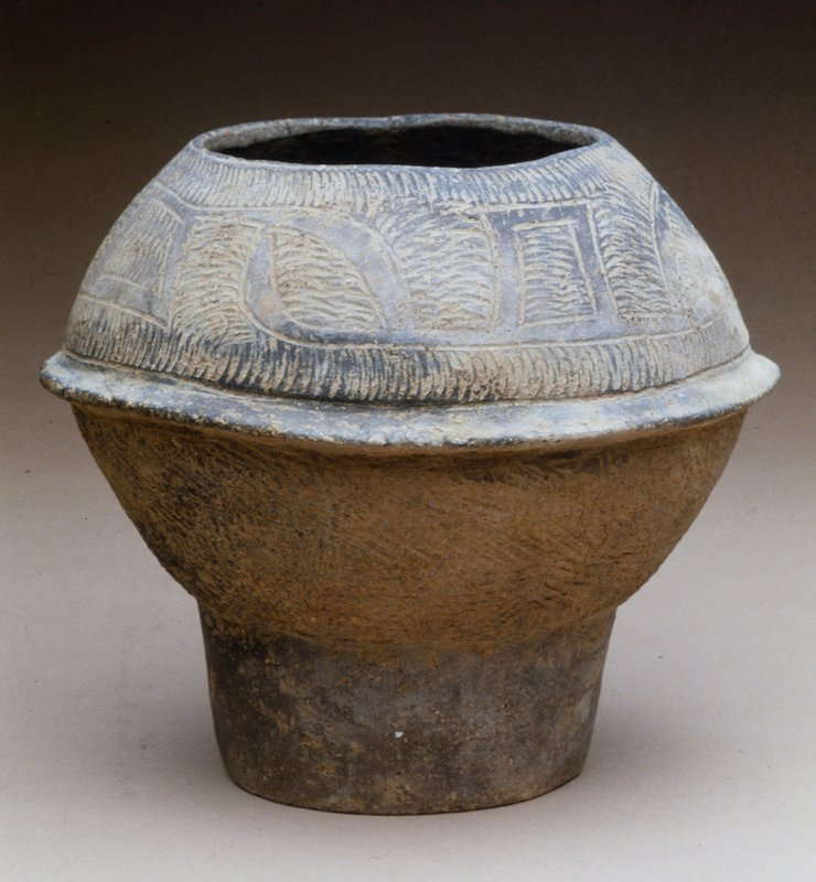 Baan Chieng Storage Jar, about 3000 B.C., black earthenware with impressed abstract design.