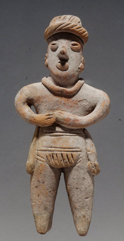 STANDING FEMALE FIGURE, hands held to chest; applique headband, necklace, facial details, loincloth and tassels, unburnished buff clay
