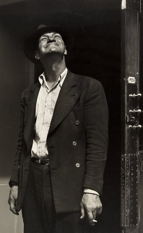 man with cigarette looking skyward