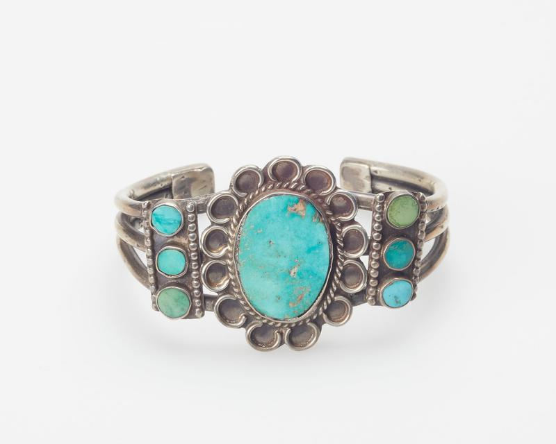 Three round wires; set with one large elliptical and six small round Arizona turquoises; bead, twisted, and looped wire decoration; Triple wire with 7 turquoise cat. 163, J#21