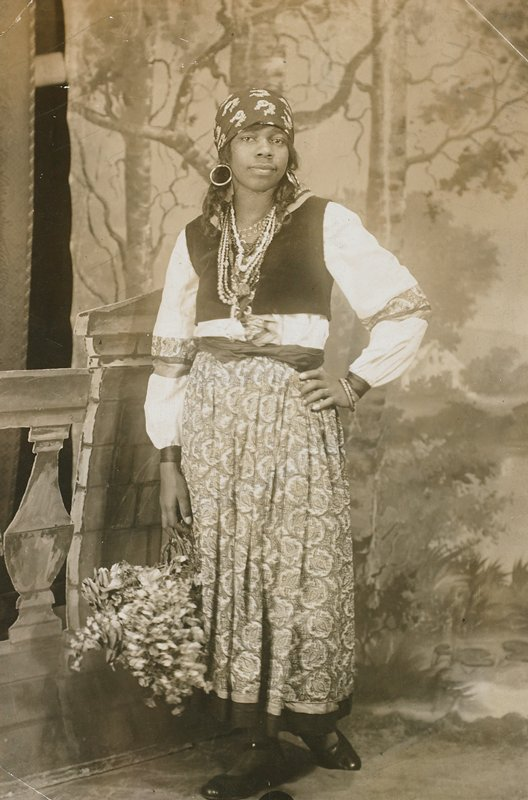 standing woman in gypsy-style dress