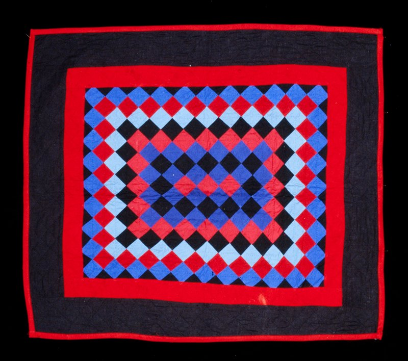 predominately diamond grid quilt pattern; red, black and blue tones