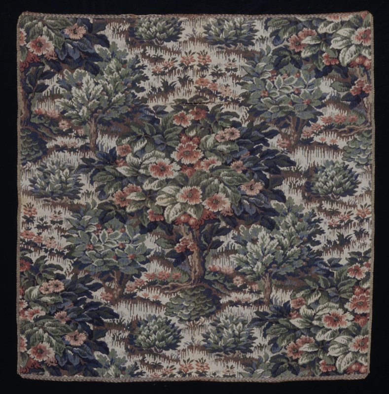 Woven textile; tree design on beige ground; large cut in central area