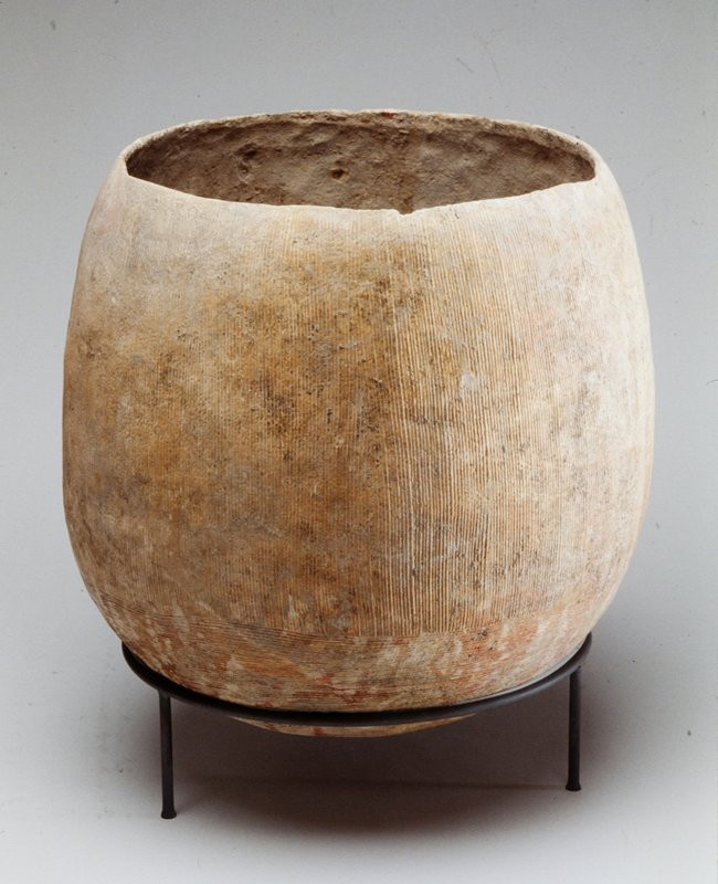 vessel with vertical, grooved striations
