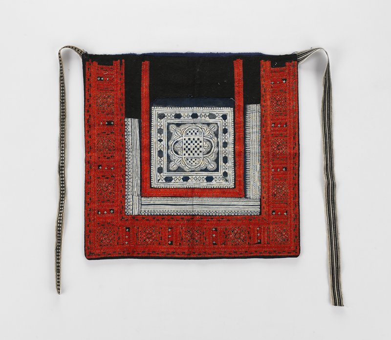 blue lining; wide embroidered border in red, orange, blue and white surrounding white indigo dyed band, surrounding second, narrower embroidered band, surrounding central square of white, indigo dyed