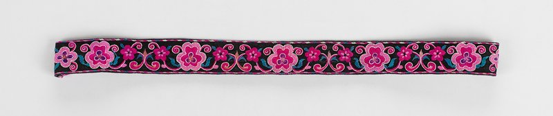 black band with floral (five large pink, fuchsia and purple flowers) embroidery; fastened with continuous elastic cord