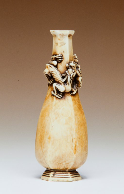 carved ivory bottle vase with hexagonal base and dragons in relief around neck