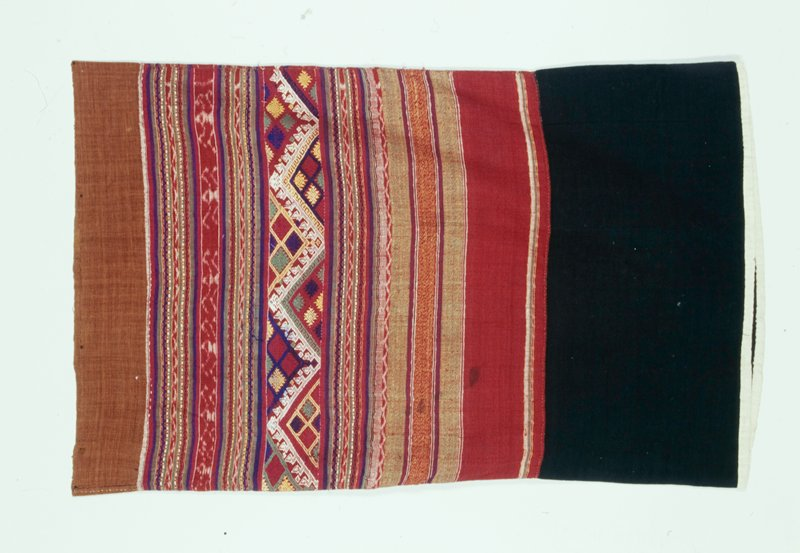 brown top band, blue band with white trim at bottom, central field red with solid and geometric patterened banding; red ikat bands