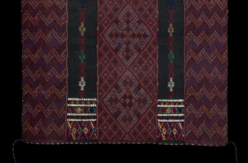 dark red; supplemental weft patterning; pink, yellow, violet, two black stripes