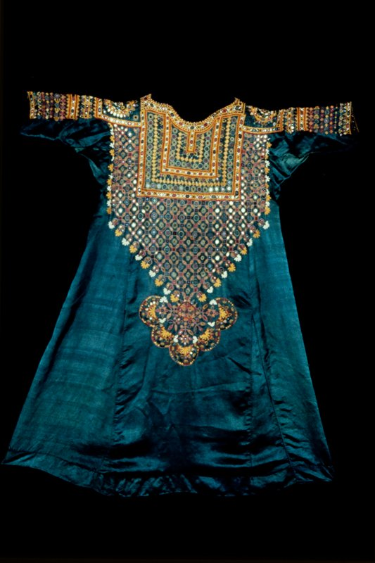 Woman's shirt and trousers; of light weight green satin; triangular ornamentation below opening for neck consisting of silk embroidery enclosing small mirror discs; similar embroidery on bottom of trouser leg