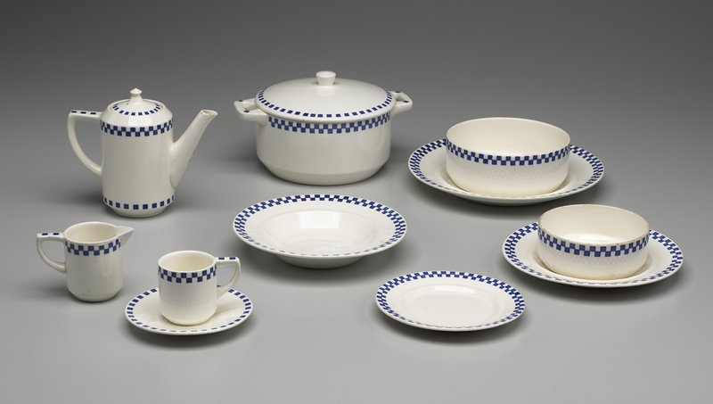 white decorated with a blue square transfer design under the glaze; matches dinner set 97.41.8.1-18
