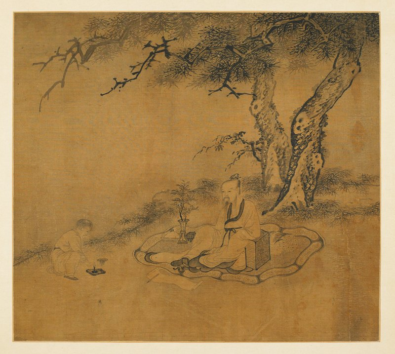 scholar seated on a carpet under a tree, paper and brush before him; assistant nearby making ink on an inkstone