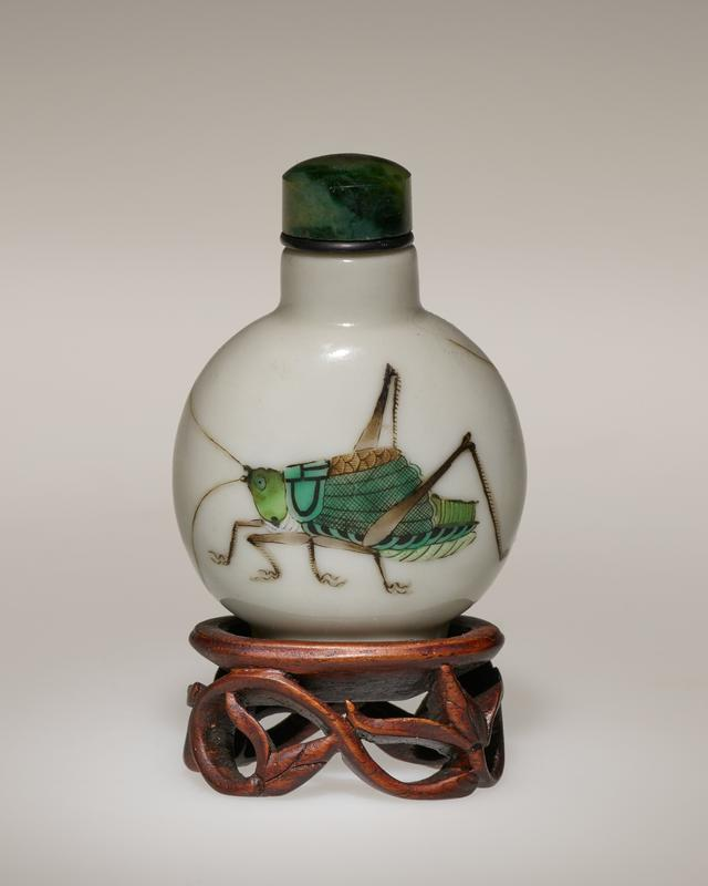 porcelain snuff bottle with dark green jade stopper; each side adorned by a large grasshopper