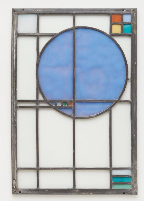 clear glass panels with blue circle off-center; light blue, green and orange squareson circle; light blue square in one corner; 4 small squares (turquoise, light blue, orange and yellow) in second corner; 3 bars (light blue, turquoise and green) in third corner