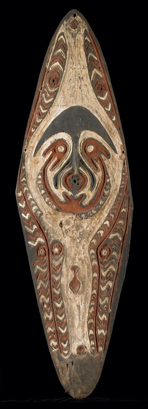 Ancestral Tablet (gope) wood with red, blue and white pigments; Kiwaumai village, Urama Island; H.41-1/2 in., W.13 in.