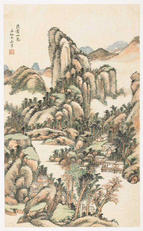 Rolling mountains and trees in green and tan with buildings at front