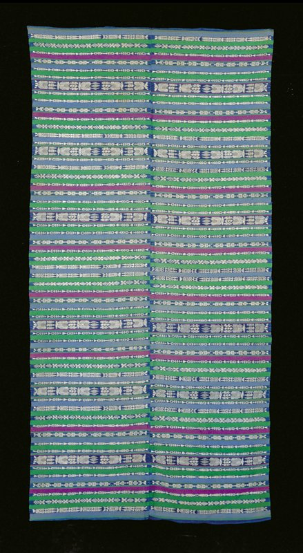 2 panels machine stitched; weft faced stripes of green, purple and blue wool and stripes of indigo dyed cotton ikat