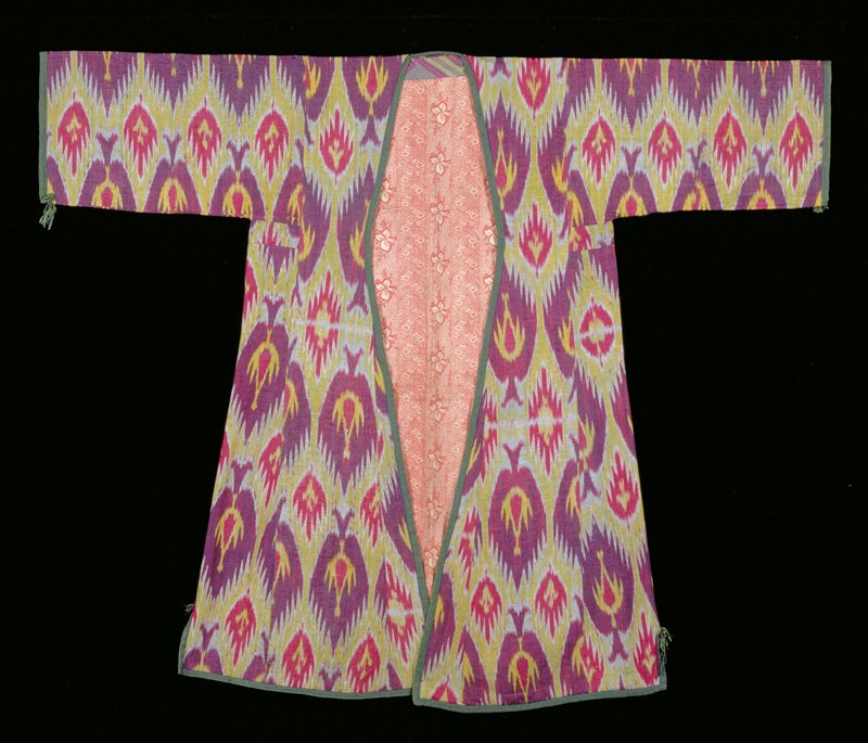 ikat in green and burgundy with red and white; red print cotton lining; green band at cuffs and edges