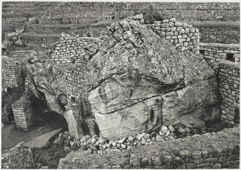 fragments of stone walls and rock formations