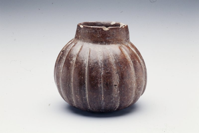 Round-bodied jar with straight neck and wide mouth; fluted design on body