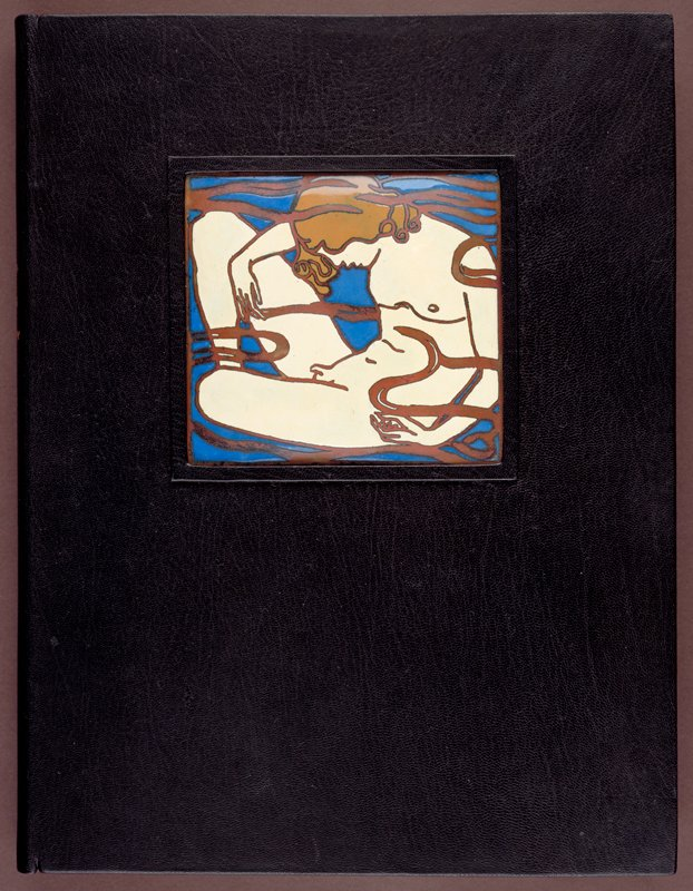 Bound in full black morocco with decorative ceramic plaque inset on front cover