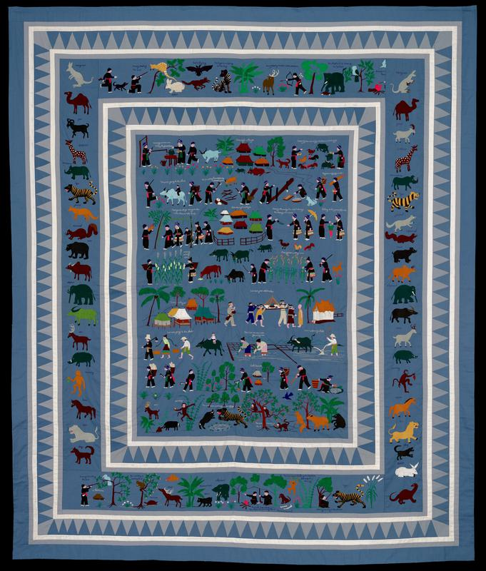 Village Story Blanket, cotton, fold and tuck applique, embroidered and lined H.110 x W.94 in; village scenes, all captioned, and outer border of animals, also labeled