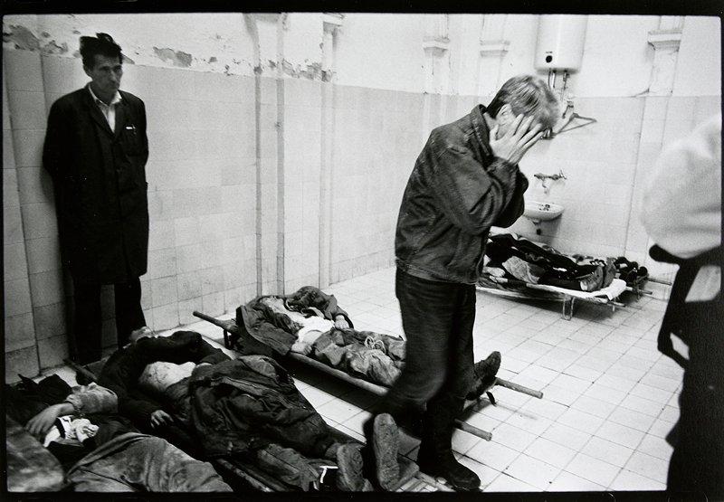 man identifying a dead body