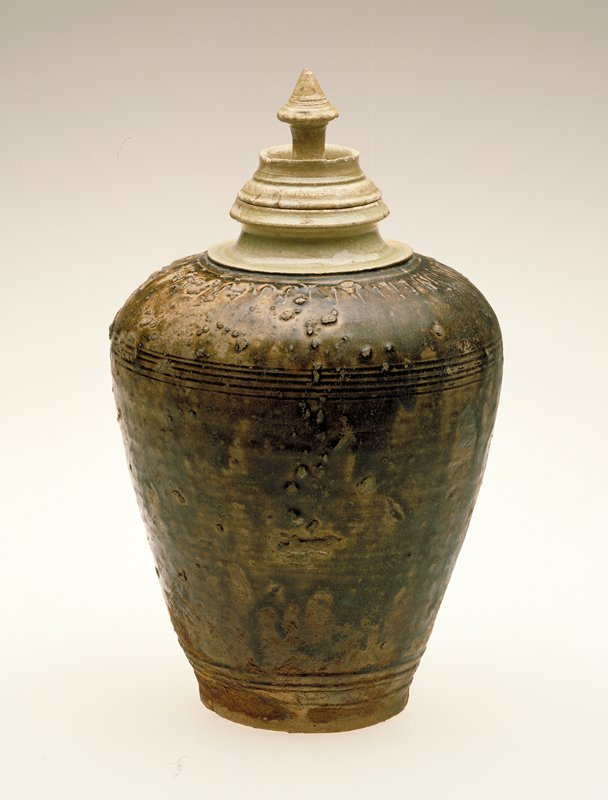 incised decor under green and brown glaze
