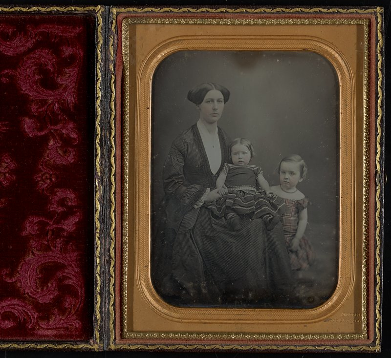 1/2 plate daguerreotype in leather case with a lyre and floral design and red velvet cushion