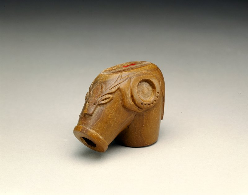 pipe bowl with elk image, about 1860, carved stone