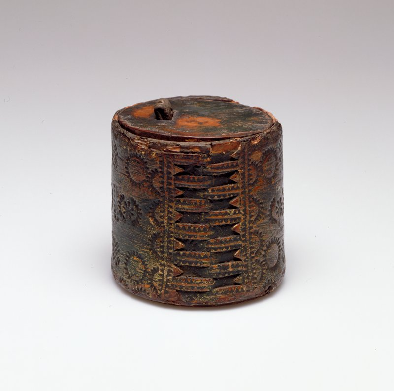 Small round basket carved from birchbark. Not woven. Small leather tab in lid.