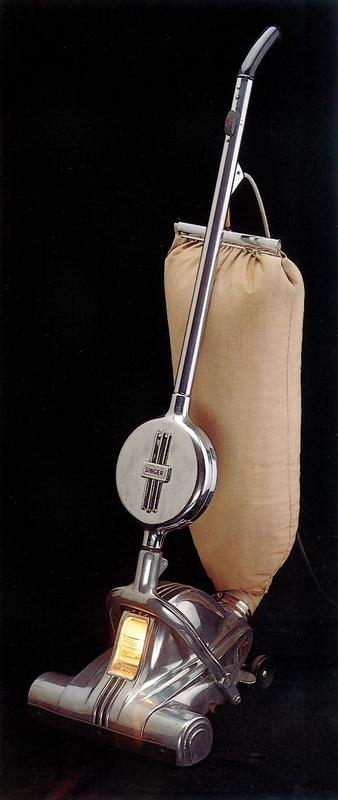 De Luxe model with automatic cord control; aluminum cased vacuum with cloth bag
